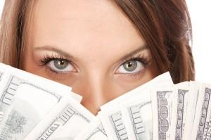 Attractive woman takes lot of 100 dollar bills