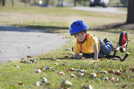 boy-falling-off-bike