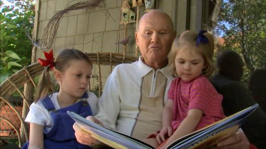 Elderly Man Reading To Children - Gift