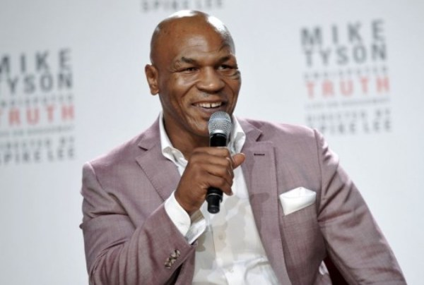 Mike Tyson Puts Toronto's CP24 News Anchor Nathan Downer In Check!